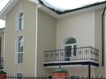 Отделка фасада сайдингом виниловым